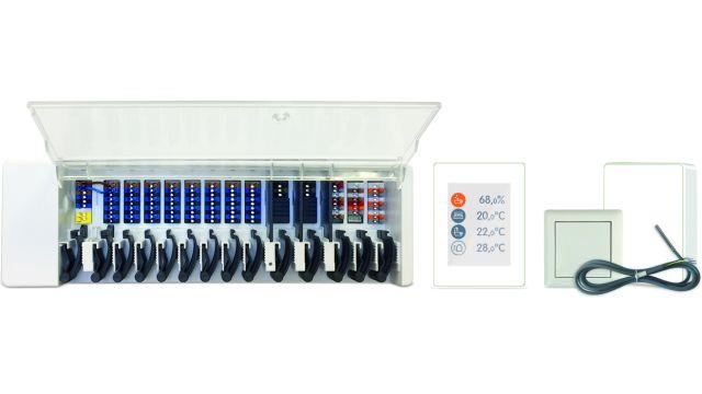 Komponenten einer Heizungsregelung; Zonenregler für den Heizkreisverteiler, Raumthermostate und Sensorik.