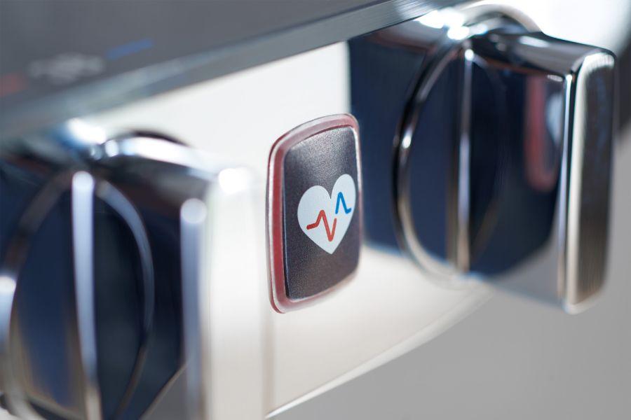 """Das Bild zeigt einen Detailausschnitt des """"Wellfit""""-Buttons am """"HansaEmotion""""-Thermostat."""