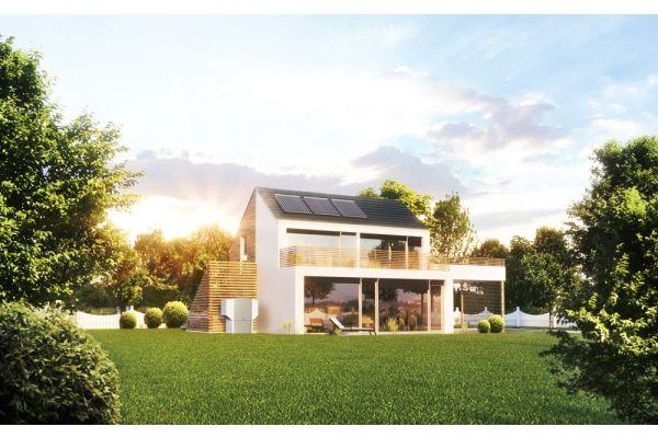 Ein Haus mit einer Solaranlage auf dem Dach.