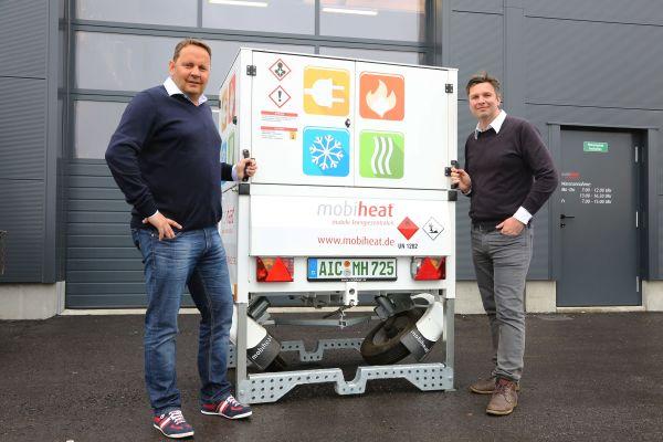 Andreas Lutzenberger, Helmut Schäffer und eine mobile Heizzentrale von mobiheat.