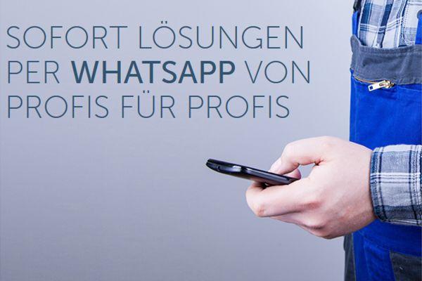 Das Bild zeigt einen Arm mit Handy in der Hand.
