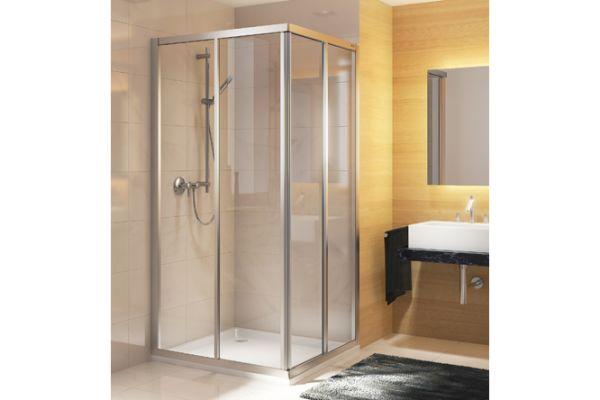 Das Bild zeigt einen Auschnitt eines Bades, in dessen linker Ecke sich die gerahmte Duschkabine