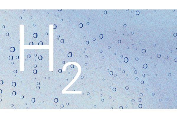 Das Bild zeigt Wassertropfen und das H2-Zeichen.
