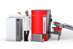 """Der neue """"Nano PK""""-Kessel und der """"Eco-HK""""-Hackgutkessel bis 330 kW."""