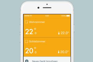 Die App der Heizungssteuerung auf einem Smartphone zeigt die individuelle Temperatur für verschiedene Räume.