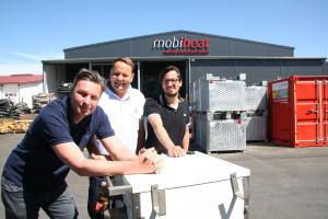 Christian Chymyn, Andreas Lutzenberger, Helmut Schäffer und eine mobile Heizzentrale von mobiheat.