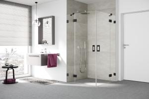 Ein Badezimmer mit einer Duschkabine.